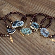Beaded Druzy Bracelet Espresso wood round beaded stretch bracelet with gold plated nugget beads. Swarovski crystals, and a statement druzy pendant. Features Function & Fringe's signature gold feather charm. Each druzy pendant has its own unique color and shape, so item may not be exactly the same as pictured. I love wearing them stacked for a fun boho look! Function & Fringe Jewelry Bracelets