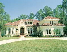 The Rembrandt House Plan is reminiscent of a European villa with its exquisite design, making it one of our most eye-catching house plans. To see the actual floor plans for this home, click here: http://www.thehousedesigners.com/plan/rembrandt-4127/