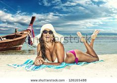 WOMAN ON THE BEACH Stock Photos, Images, & Pictures | Shutterstock