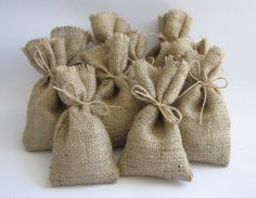 These hessian wedding favour bags are lovingly handcrafted from hessian produced here in the UK and quality jute twine.  Each bag measures approximately 8cmx15cm, and you will receive 10 bags with 10 x 30cm lengths of twine per lot ordered.  Fab for presenting your wedding favours in, and will look lovely at a shabby chic, vintage themed wedding. These bags are usually made to order so please allow 3-5 days for me to process your order, and please note that larger quantities may take longer…