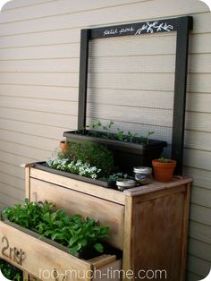 Take an old dresser and convert it to a potting bench ....hang clay pots with hangapot.com hangers on the wall or on the sides of the bench to store your tools.