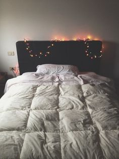 small multi-color christmas lights on the headboard all year long. perfect for cuddling in the dark <3
