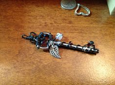 Sold. Wire wrapped key with Swarovski crystals for color accent. Www.etsy.com/shop/BlackRoseChris