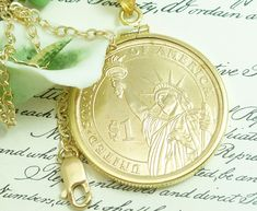 Mounted in a 14kt gold filled screw top bezel and bail, 14kt gold filled 19 inch chain included. The coin has been mounted so that Lady Liberty faces