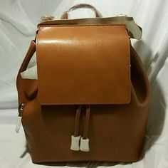 "HP  SALE BARNEYS NY Cognac saffiano leather Front flap zip pocket at side polished gold tone hardware. Lined with black twill. Leather zip pocket at interior. Flat leather handle.  Adjustable leather shoulder straps. Drawstring closure at topline. 2"" handle drop. Will fit 12"" electronics (as shown). India. (barneys new york) Bags Backpacks"