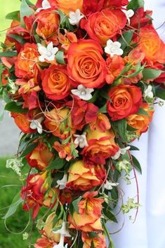 cascading fall wedding bouquets pictures with red | Fall cascade bouquet