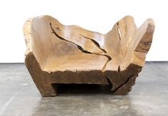 The designer: França has been hand-carving his signature single-piece sofas, tables, and chairs from Brazilian pequi trees for years because of their rich golden color and satin-like finish and feel. He strictly uses only naturally downed or felled trees left behind by clear-cutters, and naturally, every piece is unique.