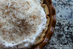 Coconut Cream Pie is on every Christmas dessert table at every holiday party my family...