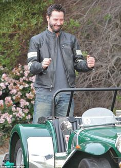 It wasn't only motorcycles: Keanu admired this green vehicle at the Malibu event