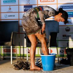 World Champ Marianne Vos cleaning up post race with a bucket of water. The greatest athlete of her generation.