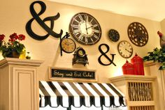 I love love love this collage of clocks and the ampersands! This kitchen is amazing!