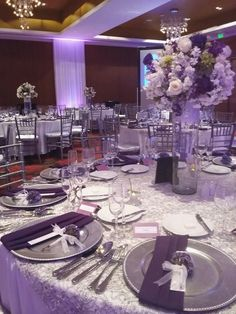 7 Exceptional Purple Color Combos to Rock for wedding centerpieces o. 7 Exceptional Purple Color Combos to Rock for wedding centerpieces on the silver glitter tablecloth, luxurio. Plum Wedding Centerpieces, Purple Wedding Tables, Silver Wedding Decorations, Purple And Silver Wedding, Reception Decorations, Wedding Colors, Wedding Flowers, Purple Table Decorations, Engagement Decorations