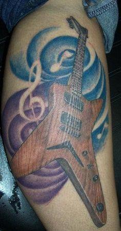 Look at woodgrain. Gibson Explorer style tattoo. For more guitar articles, visit www.guitarjar.co.uk