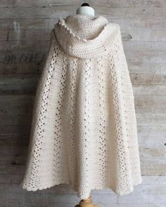 back of white crochet cape