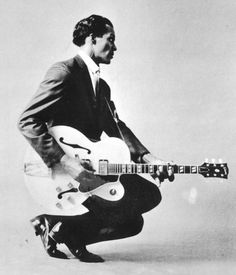 """A youthful Chuck Berry performs his trademark """"duck walk"""