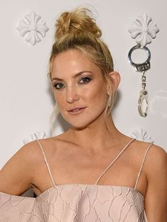Kate Hudson Tousled Topknot with sun-kissed cheeks   allure.com