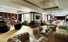 The Ritz-Carlton Berlin's Club Lounge (pictured) is like a mini-hotel inside the 303-room ...