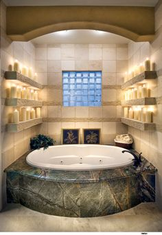 Love the candle shelves in this master bathroom...so romantic!