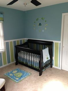 Our Turtle Nursery - 2013 Me: Like the chair line and the stripes. Cute!