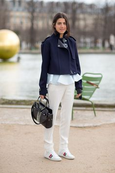 Leandra Medine in a layred outfit, whtie pants, Saint Laurent sneakers. Paris Fashion Week, Street style.