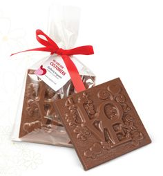 """Belgian Chocolate Love Bar with Custom Imprinted Hang Tag (1.3 oz)Solid Belgian milk chocolate with stock """"love"""" mold. Great for wedding favors, Valentine's Day or to promote """"we love our customers""""."""