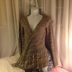Unique cardigan from BKE great condition Lite brown cardigan with printed material on cuff area of arms and trim of sweater last pic is back of cardigan thin not heavy perfect for any season would fit xs-med BKE Sweaters Cardigans