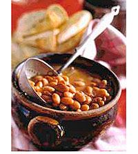 In Mexico, frijoles are served either soupy in broth or mashed and fried. This mouthwatering recipe, with pinto beans and salt pork, features both versions.