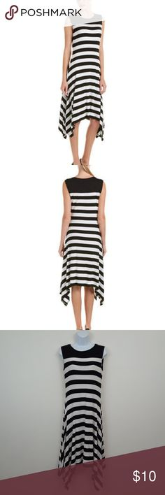 VINCE CAMUTO STRIPED SHARK BITE DRESS Size small High low hemline Black and white stripes Sleeveless  Jersey knit  95% viscose 5% elastane Vince Camuto Dresses Midi