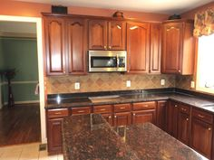 Tan Brown Granite Kitchen Countertop of Kitchen Island with Freestand Wooden Cabinet and Nice Tile Backsplash Design for Country Kitchen