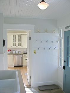 laundry room: love wainscotting, school house light and ceiling.