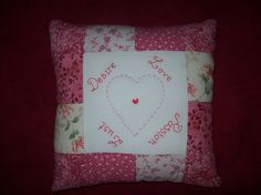 Patchwork cushion, with hand embroidery.  Please look at the items I sell @ www.leyaed-for-you.webs.com, thanks.