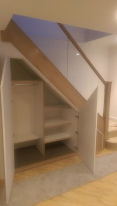 Oak and glass staircase refurb with new under stairs storage