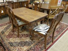 This antique swivel top table works just like a game table; opens & closes with drawers. Only $499 for the table and the set of 4 chairs $299.