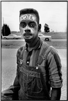 "Bruce Davidson USA. Alabama. 1965. Young man with ""Vote"" painted on his forehead walking in the Selma March  Magnum Photos"