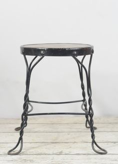 Up for your consideration is an antique short wrought iron ice cream stool.  The condition is very good The seat is aged but still in good