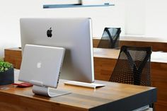If you use a MacBook Pro with Apple's Thunderbolt Display, you know how quickly your desk can become quite messy. The Just Mobile AluRack is designed to keep things neat. Designed in Denmark by the award-winning Jakob Wagner, the AluRack screws together through the hole in the stand of your iMac or Thunderbolt Display, creating a shelf for your notebook to rest in while docked.