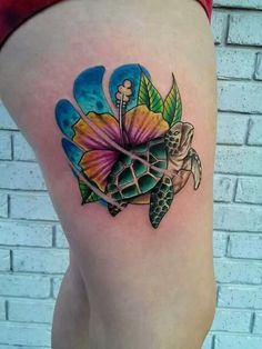 Ses turtle and hibiscus tattoo by Mike Hughes of Hallowed Point Tattoo in Palm Bay Florida.  HallowedPointTattoo.com