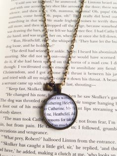 Wuthering Heights, Emily Bronte, 1847  This necklace is so unique and the perfect gift for any Emily Bronte fan!  Handmade with inspired vintage Wuthering Heights book pages, this necklace makes you feel like youre a part of the story! Dont worry book lovers, no books are ever harmed in the making of my jewelry! :)  This necklace is made complete with a tiny little bronze heart!  Make a HUGE statement and get tons of compliments with this necklace!  This necklace comes on a bronze 24 inch…