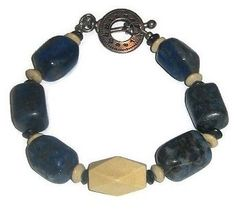 This men's bracelet by AngieShel Designs is made up of sodalite and wood beads and measures 8 inches with its sturdy silvertone clock toggle clasp. This trendy bracelet will certainly complement your look.