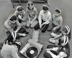 Kids sharing record player with headphones