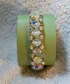 SWAROVSKI and sterling silver aurora borealis faceted bead bracelet right…