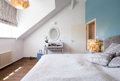 Bedroom features a blue grey wall, master bed and Mother of pearl chandelier. Pearl Chandelier, Chandelier Bedroom, Blue Grey Walls, Bedrooms, Interior Design, Furniture, Home Decor, Courtyards, Nest Design