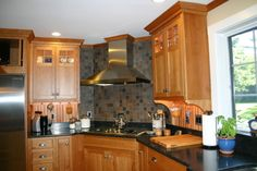 kitchens with hoods in the corner | We have a corner 5 burner cooktop with a chimney hood. Sorry I haven't ...