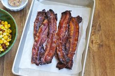 Candied Bacon  This is a fantastic Candied Bacon recipe that I had adapted from Food Network's Bitchin' Kitchen, Nadia G. In one of the episodes, Nadia transformed plain smoked bacon into this tasty treat. It's sweet, salty, and slightly spicy. I have made this many times for snacking as it's really good. I even made some candied bacon butter out of it. :)
