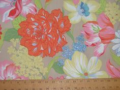 snagged a few yards of this at All About Fabrics yesterday.  I'm planning to hem it and make it our spring tablecloth