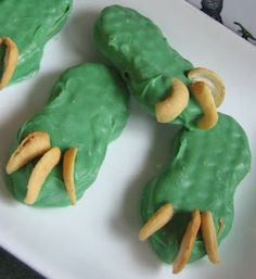 Dip Nutter Butter cookies in candy melts = Dinosaur claws!