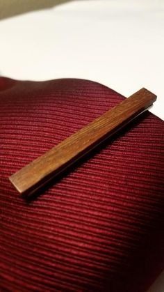 371e110401fb Check out this wood tie bar atop a metal clasp. Completes an office  professional look.