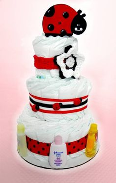 Tessa from www.sweetcheeksdiapergifts.com made this adorable diaper cake using products she found at Hobby Lobby!