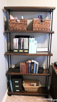 """Industrial pipe shelving is currently all the rage! Check out this tutorial by Amanda Michelle from Well-Groomed Home on how to create an <a href=""""http://wellgroomedhome.com/2014/02/industrial-pipe-bookcase.html"""" target=""""_blank"""">Industrial Pipe Bookcase</a>."""
