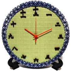 A clock made of Japanese tatami mat. I especially like the numbers in kanji characters.
